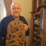 Lennart Mårtensson with a carving of Ganesha from India, one of the collection of elephants at his inn in Sjöbo.